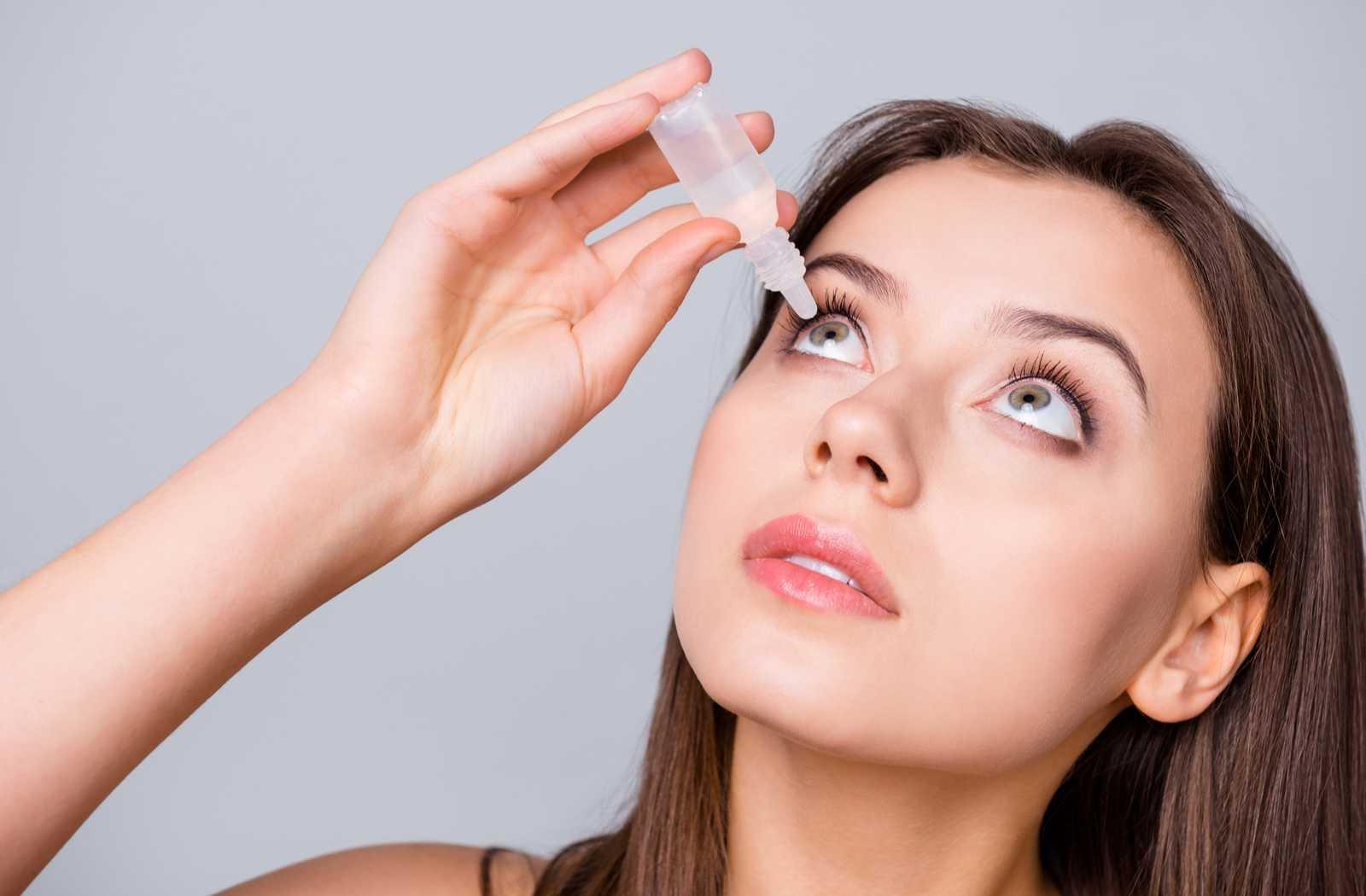 woman applying prescription eye drops