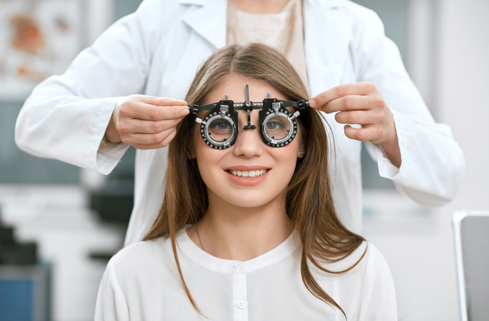 Young lady looking at camera during her vision check from optometrist.